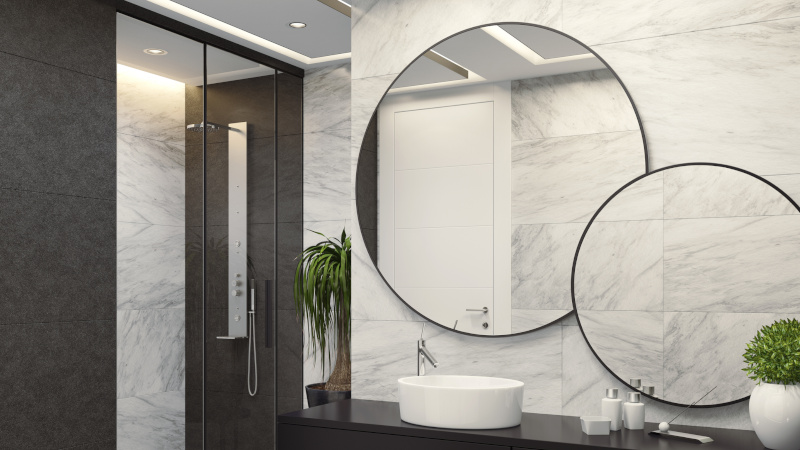two round mirrors with black frames