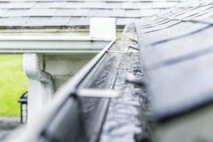 maintain your gutters by cleaning them