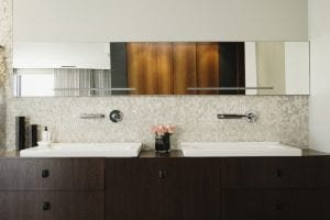 installing bathroom mirrors with vintage-looking gold
